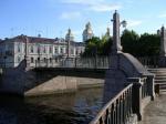Раскольников на фоне советского моста