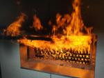 Панели KMEW (серые, фактура «рисовая бумага») выстояли при максимальной температуре 890 градусов без единого выпадения фрагмента, тем самым доказав своё высокое качество и пожаростойкость