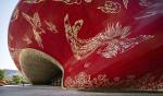 В Гуанчжоу построили театр с фасадом как будто из расшитого золотом шелка