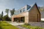 Титан-цинк и натуральное дерево. Частный дом в Ратингене