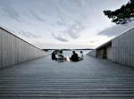 Дом-терраса на финских скалах: нарисованный в парилке, построенный за рыбалкой