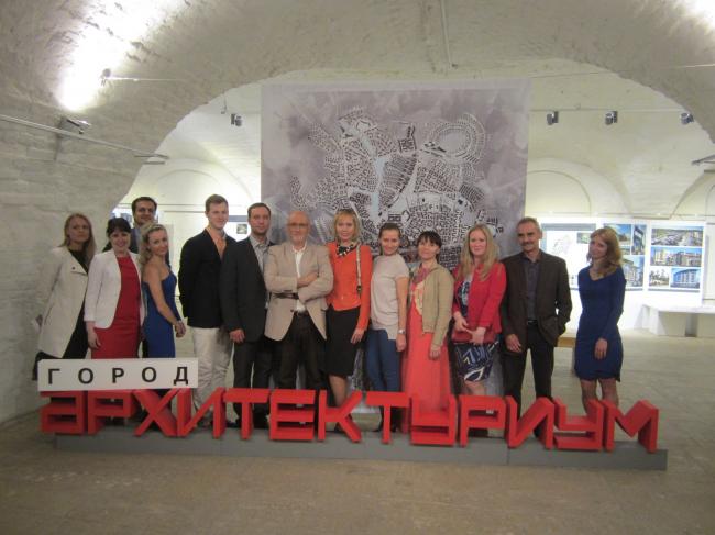 """The team of the studio at the exhibition """"Architecturium City"""" © """"Architecturium""""/ Yuri Pankratov"""