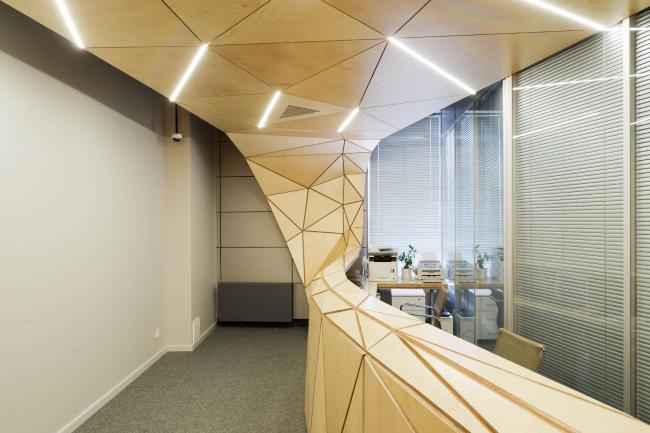 The interior design of the reception area of MGPM. © Totan Kuzembaev Architectural Studio
