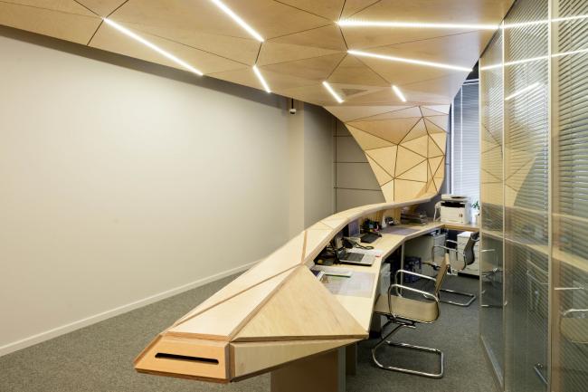 The interior design of the reception area of MGPM © Totan Kuzembaev Architectural Studio