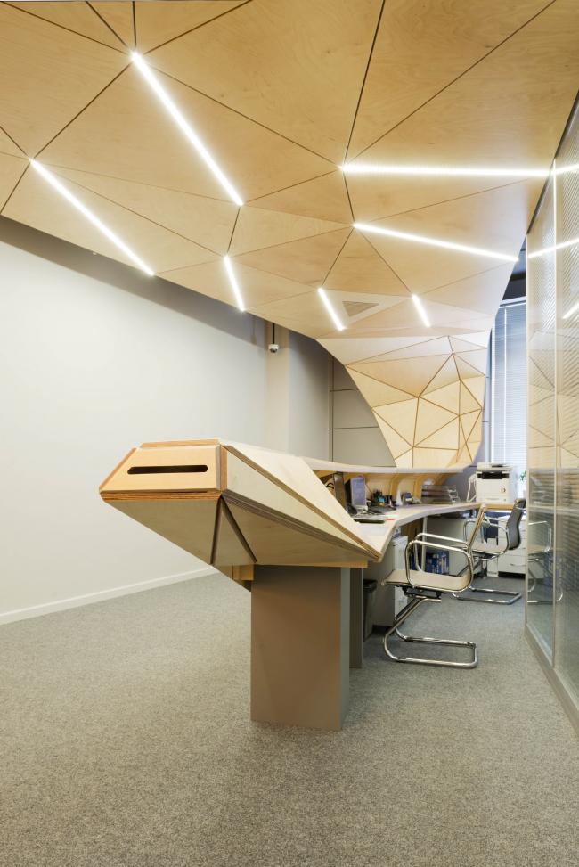 The interior design of the reception area of MGPM. Backlight © Totan Kuzembaev Architectural Studio