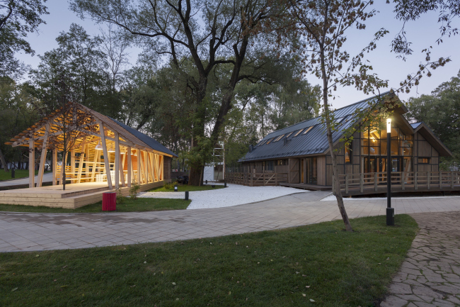 The house for master classes (left) and the cowshed(right). Urban farm at VDNKh, 1st phase. WOWhaus Bureau. Photograph © Dmitry Chebanenko