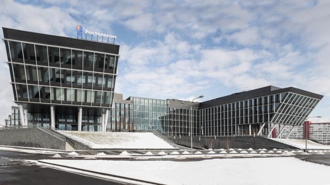 Офисный парк «Comcity» на Киевском шоссе, в котором расположен интерьер офиса компании «Ростелеком». Архитекторы Cigler Marani Architects. Фотография предоставлена Aurora Group