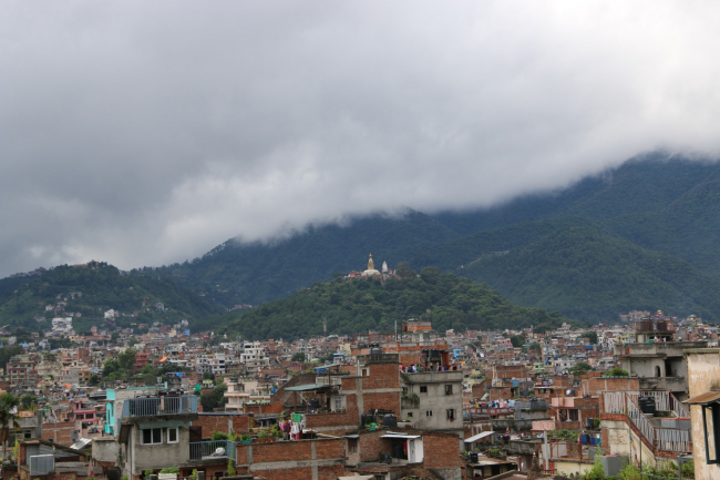 The Swayambhu hillock with the Mahacaitya which used to be an island now overlooks a sea of houses. © Kai Weise