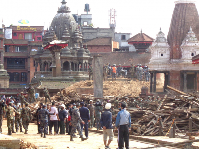 Salvaging work going on after the earthquake with help from army and police, Patan Durbar Square. © Kai Weise
