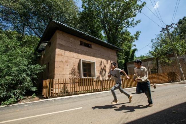 Реконструкция деревни Гуанмин после землетрясения (Китай).  Архитектурная школа Китайского университета Гонконга. Изображение предоставлено WAF