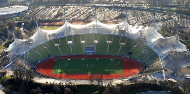 Олимпийский стадион в Мюнхене. Фото: 2014 Olympiastadion Munich  via Wikimedia Commons. Лицензия  CC BY-SA 3.0
