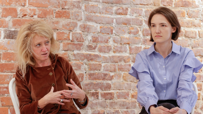 """Sasha Gutnova and Maria Panteleeva share with Maria Troshina about the project """"New Element of Settlement: History of the Future"""". Photo by Timofey Moskovkin"""